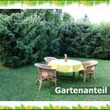 Garten mit Sitzecke - Ferienwohnung Heil
