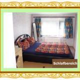 Schlafzimmer - Ferienwohnung Heil