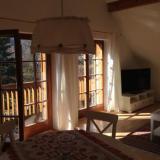 Wohnzimmer mit Balkon - Ferienwohnung Brendel