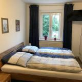 Schlafzimmer - Ferienwohnung An der weißen Mauer